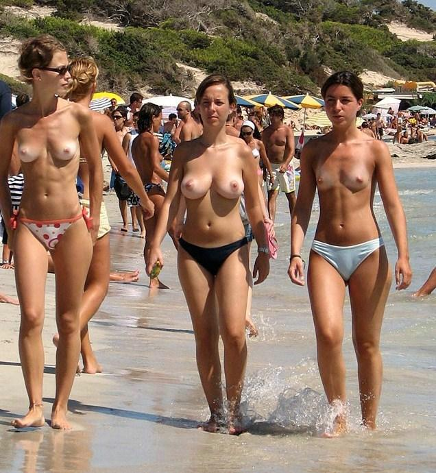 Babes day at the beach topless wearing cute bikini having trained body and charming boobies