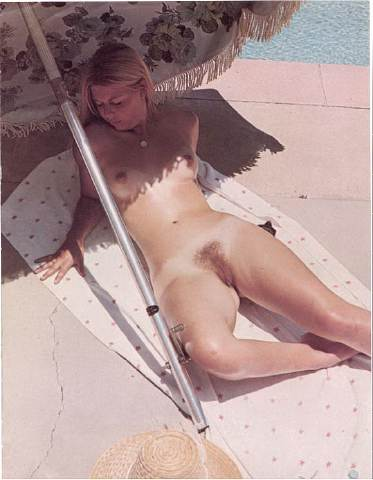 Blond hairy cunt exposed on pool side shore tanning at the sun with her beautiful juicy slit for stranger eyes