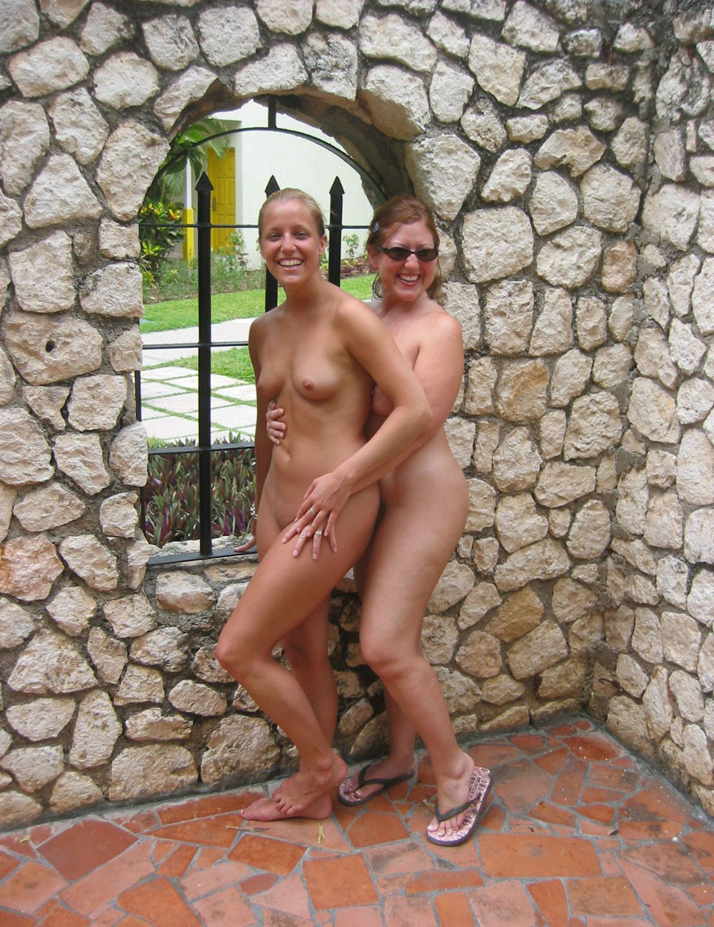 Happy wild girls show their treasure naked bodies in an old house revealing some cute titties and hairy pussy pubes
