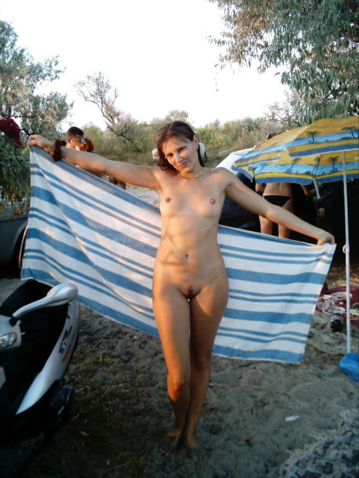 Nudist camp caught hot girl naked with a furry stripe at her twat revealing sweet and gorgeous boobies