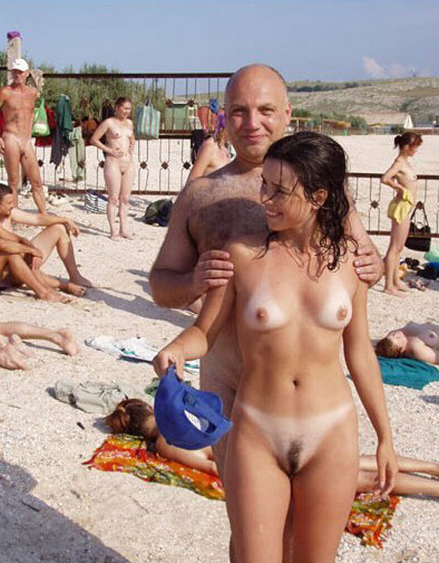 Nudist youth amateur couple on beach with wild hairy pussy for camera