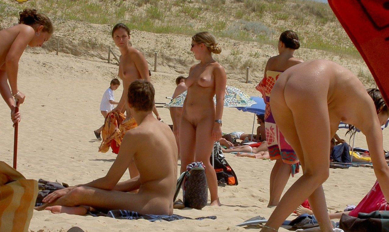 Nudist youth caught naked on exotic wild beach full of women exposing their warm juicy pussies and white butts