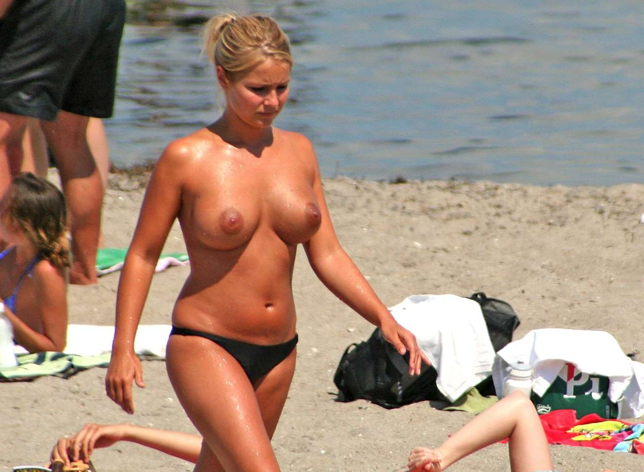 Sweet blond girl topless on hot sands revealing perky hard ...