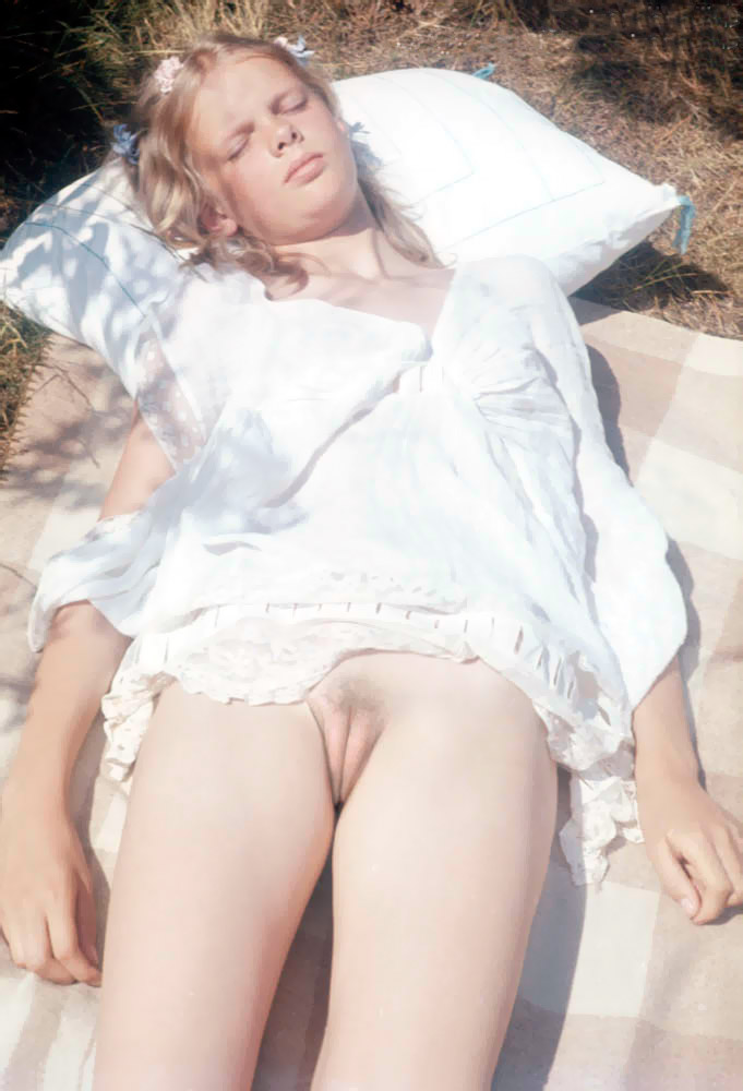 Sweet tasty burger lips sleeps in the nature and blond babe enjoys the sun