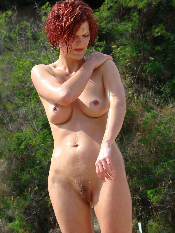 Aged redhaired nudist babe reveal her curly furry twat in the nature on beach
