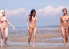 Beautiful young models caught naked on the beach shore in a photo shot art work exposing their wonderful bodies