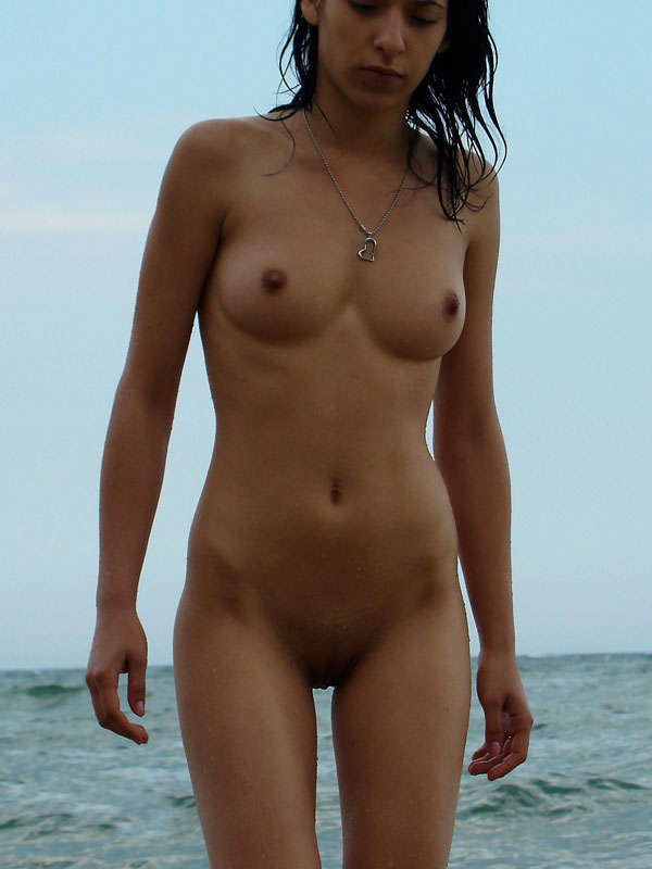 Cool brunette taking a bath under the twilight wet tanned beautiful worked body