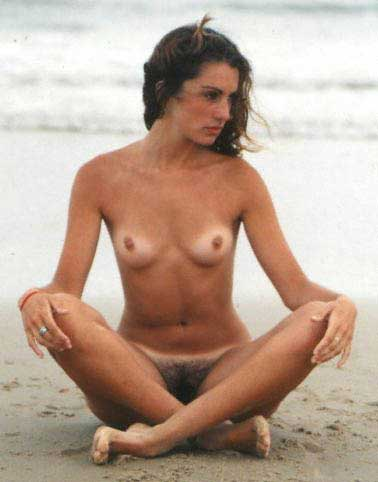 Hairy pubes and topless girl lays nude on an empty beach