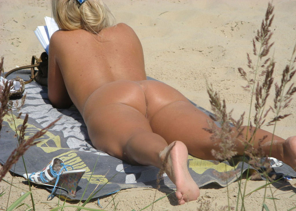 Awesome student girl on a nudist beach exposing her ass crack and labia
