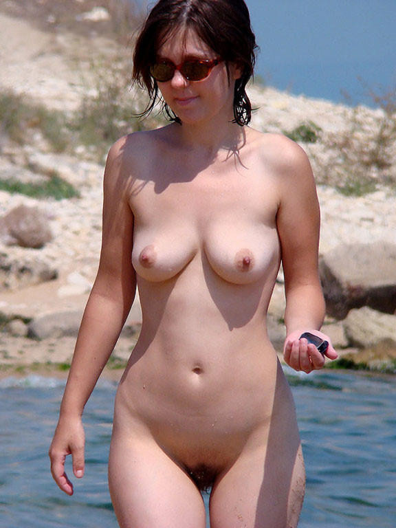 Brunette sweet chick wearing sunglasses expose her excited boobies and a delicious furry twat