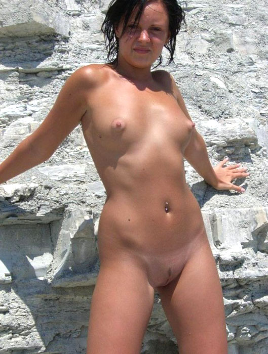 Hard pointed nipples and a sweet pussy exposed on a rocky beach