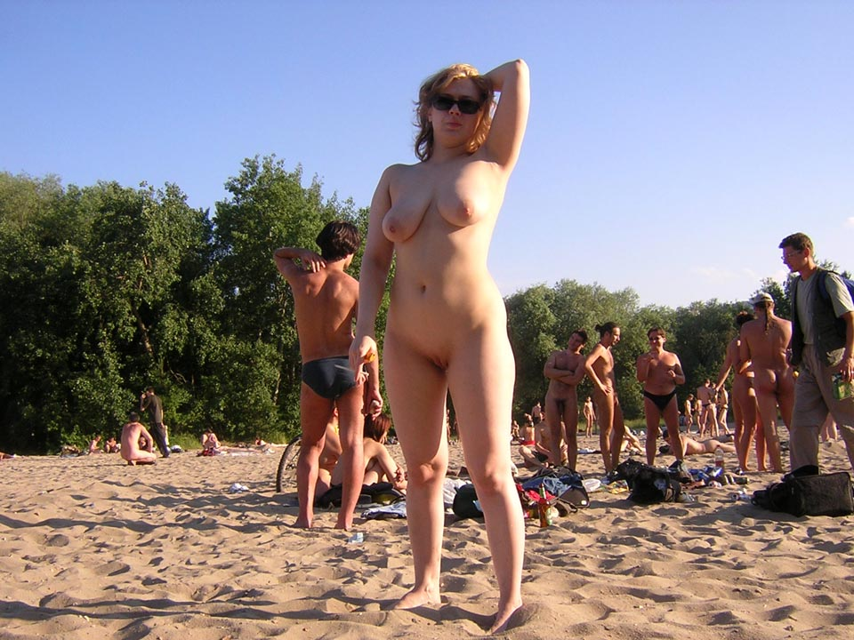 Hot lady caught naked on the beach with her delicious shaved muff and saggy big tits