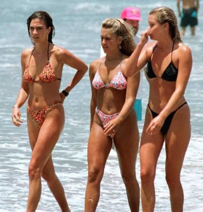 Naughty wild girls with awesome bikini suits walks on the nudist beach