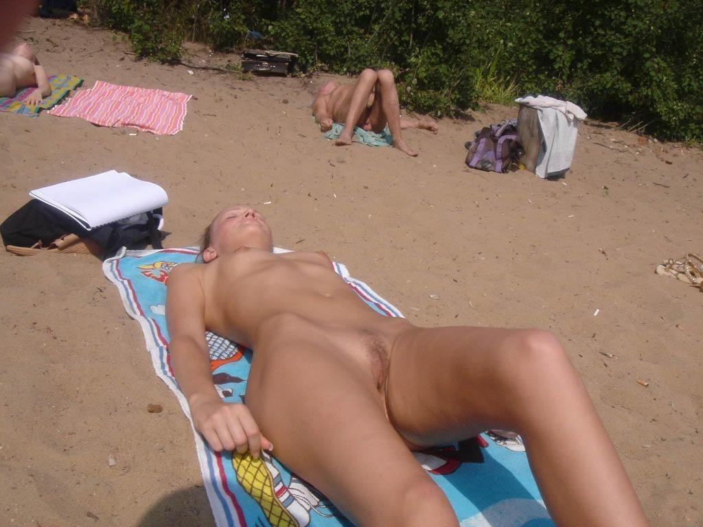 Sleeping beauty caught naked at the beach by spy reveal her tasty nice slit shaved and warm