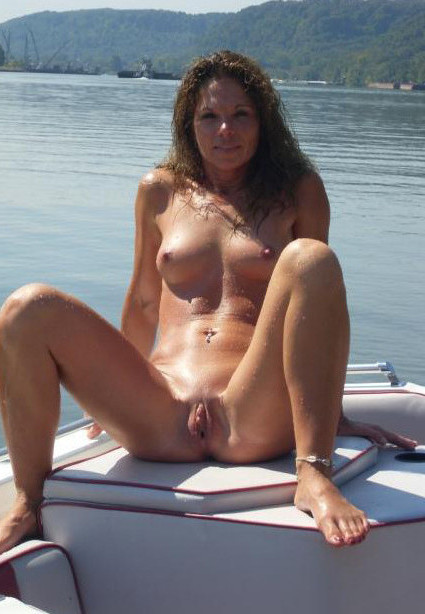 Lake view on a yacht made even better by a lusty young nudist maiden