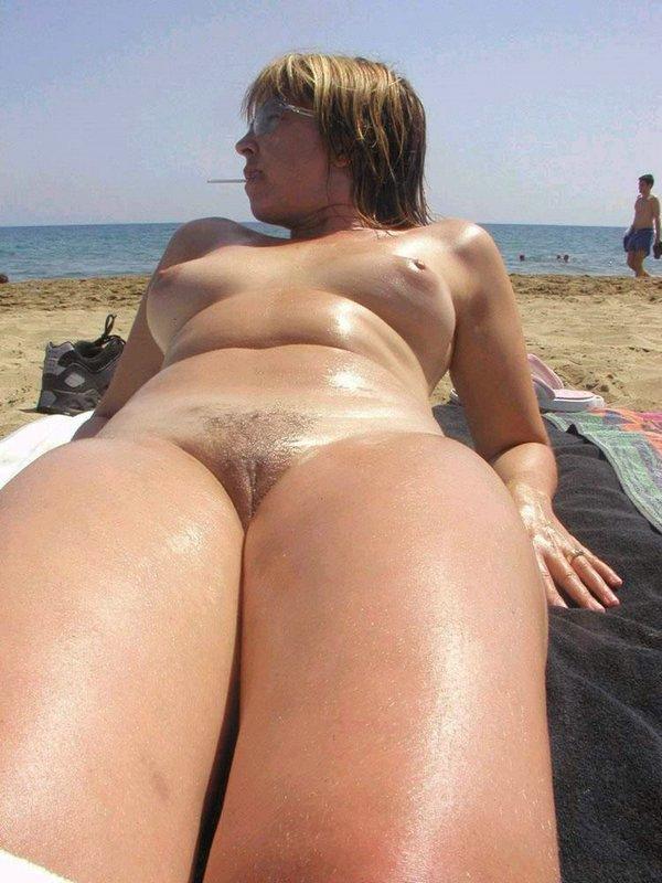 Naked pretty damsel unaware of hidden camera down south