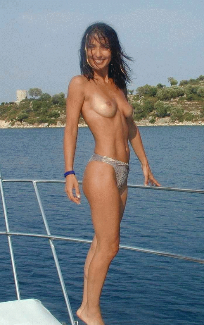 Raven haired beauty striking a pose on a yacht
