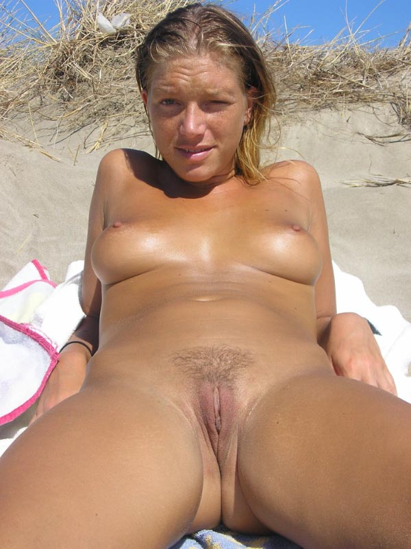 Young nudist getting used to what the sand and sun has to offer