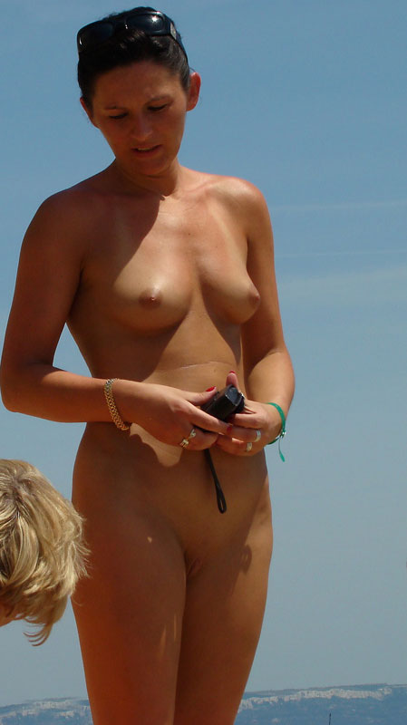 Young nudist with shaved muff is the voyeur to be spied on