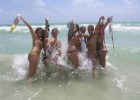 College girls getting wet and wild in the shoreline