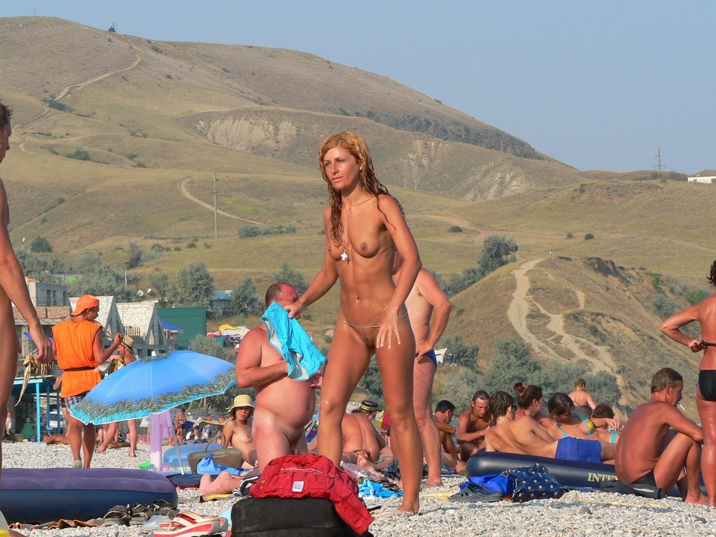 Hot naked cougar being ignored in a nudist beach
