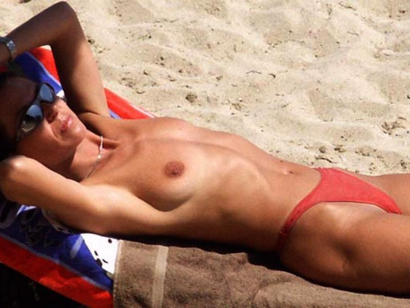 Hot stunning young nudist sunbathing under the golden sun