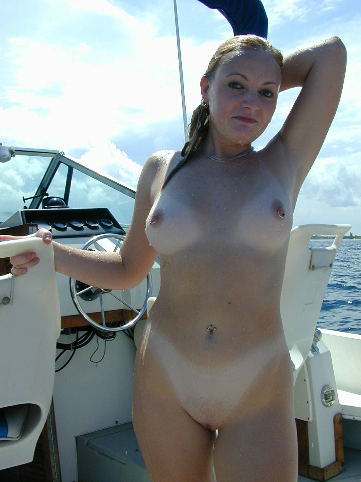 Lascivious naked babe shows her tan lines for a boat ride