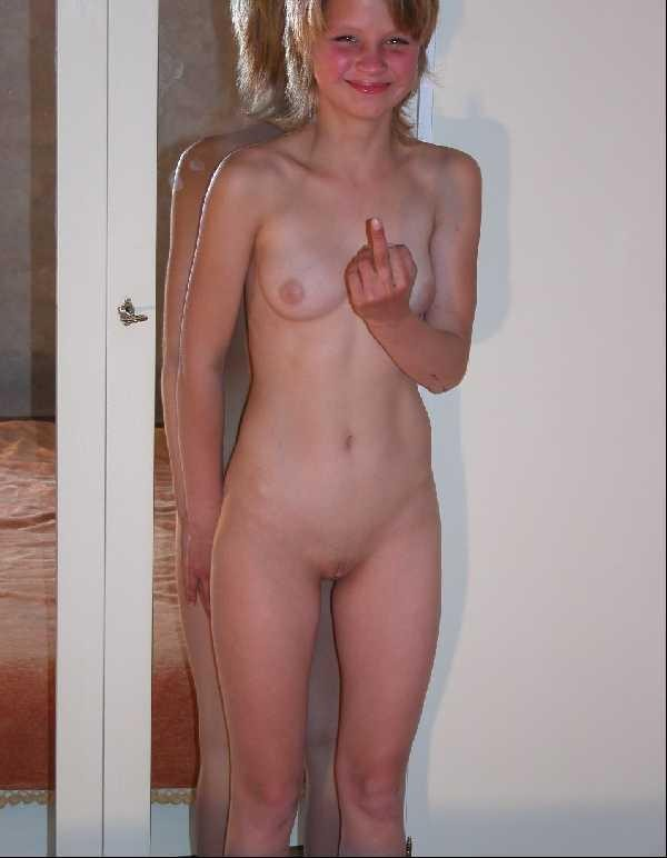 Naked blonde caught off guard by photographer