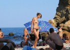 Sizzling hot topless model walking aimlessly after finding the beach crowded and freakish