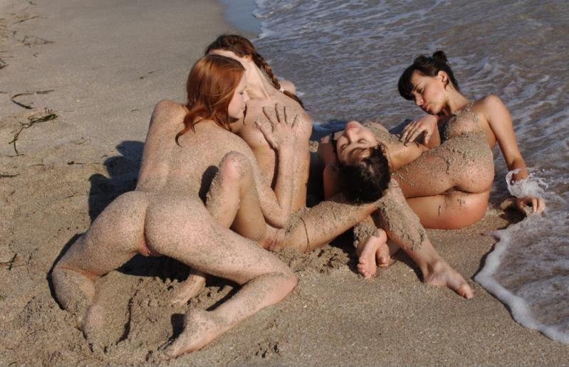 Four hoes intertwined and covered in the sand