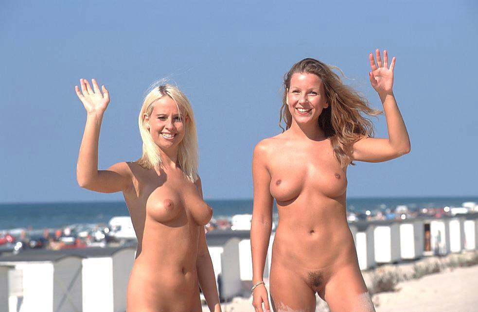 Naked babes with perky tits are waving to the photographer