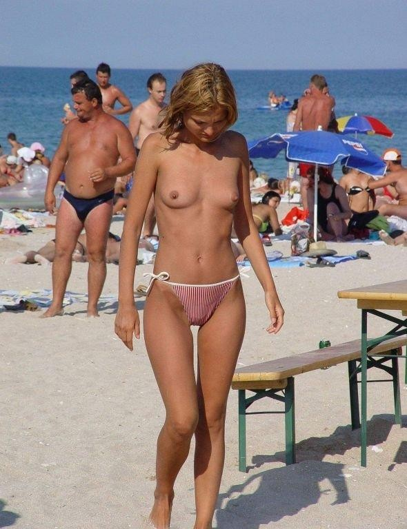 Student girl with bloomers flaunted on the sandy shore