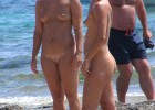 These lovely chicks are completely naked at the beach