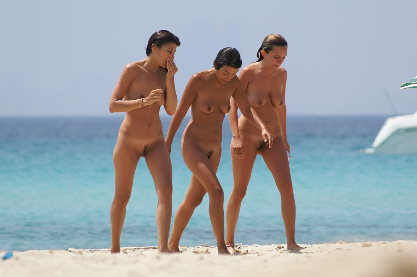 Three hot babes showing their nude bodies on the beach