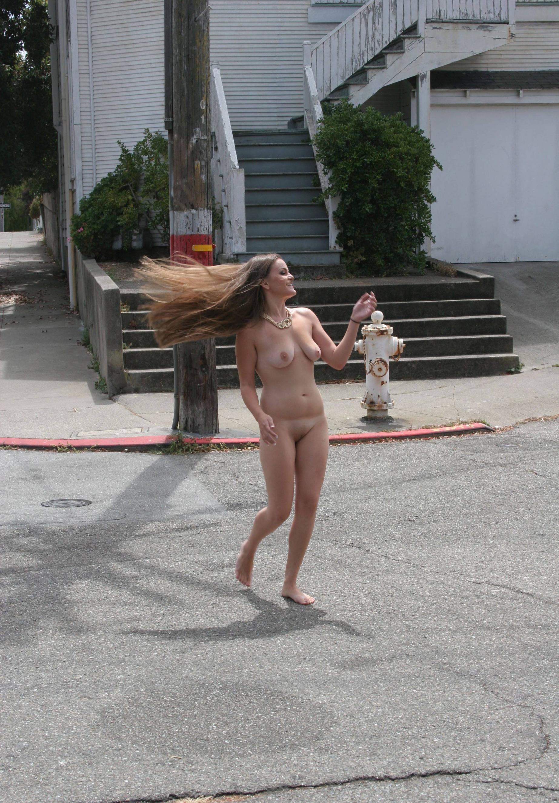 Long haired babe walks around naked