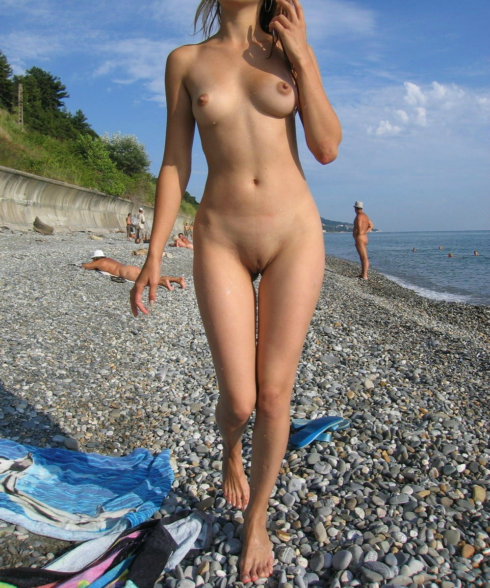 Sexy babe shows off by the sea wearing nothing