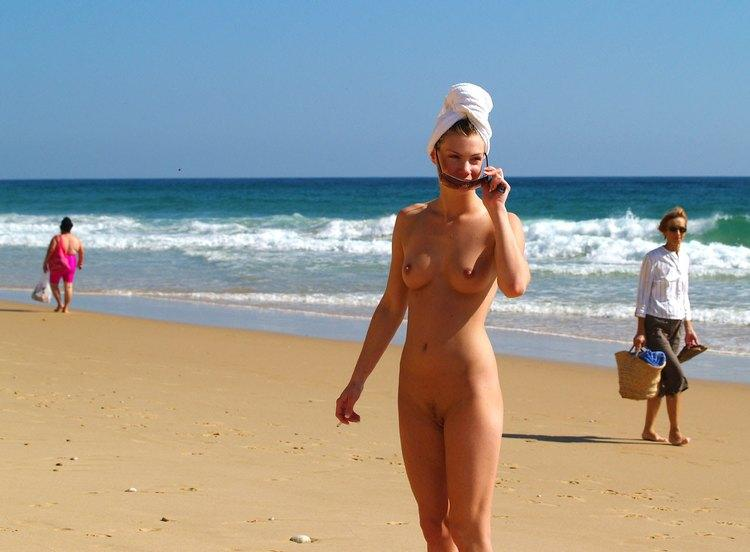 Drying her hair on nudist beach