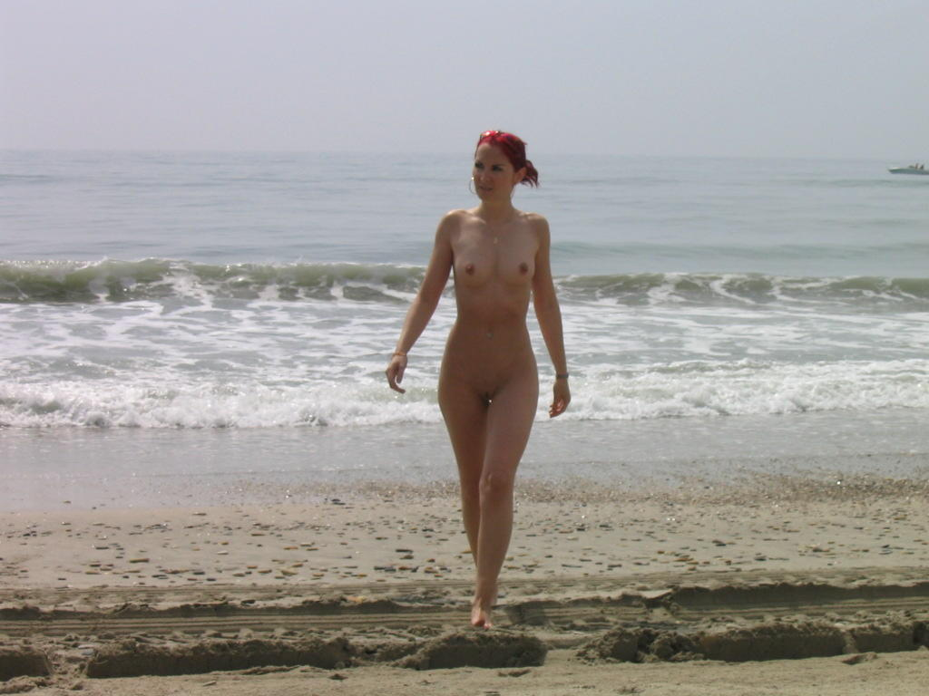 Naked redhead is what you want to see at the beach