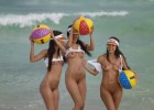 Playful naked babes with their beach balls