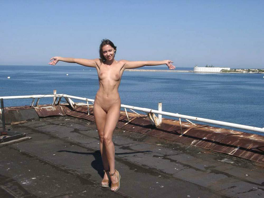 Happy girl enjoying nude a great day