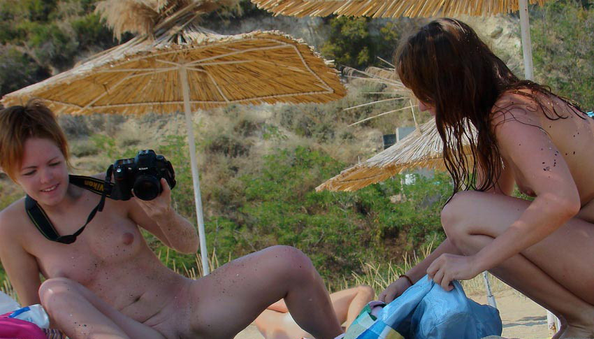 Nude babes with a photo camera exposed