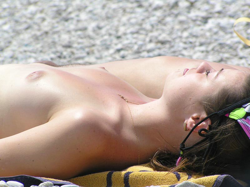 Sleeping topless on the beach