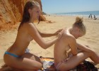 Sexy topless teens rubbing lotion on each other