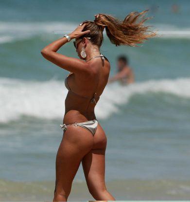 Tan brunette in bikini