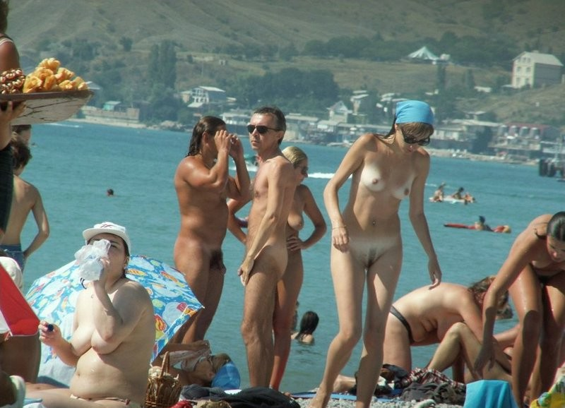 Group of friends enjoying the nude beach