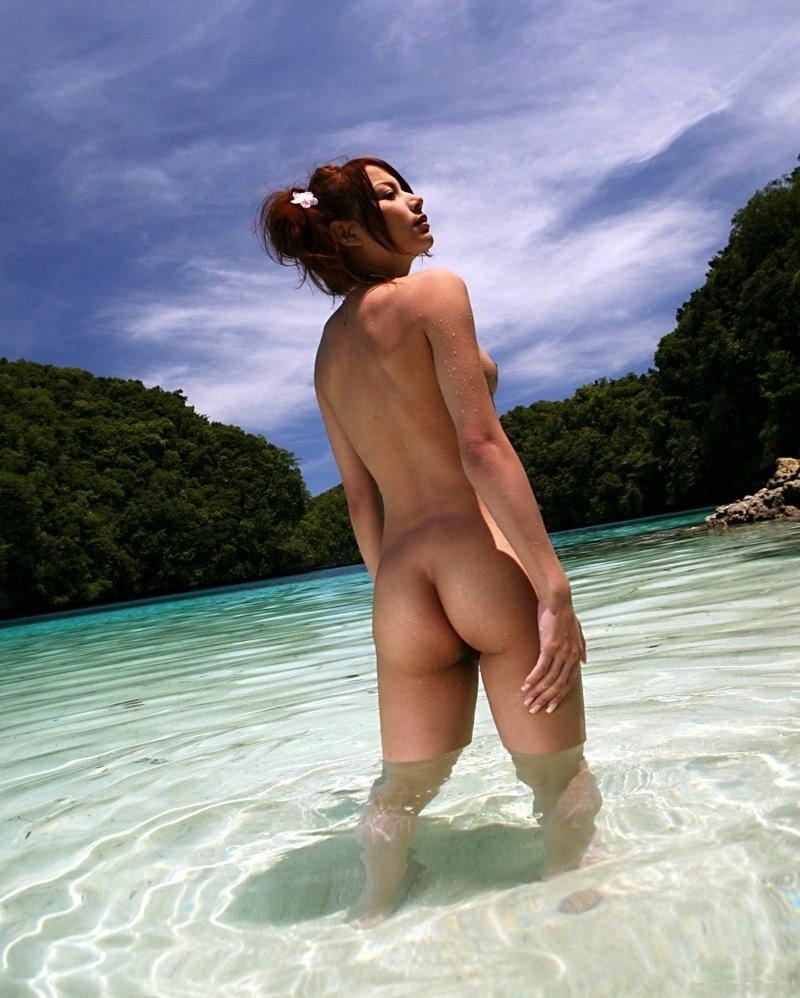 Ginger cutie playing naked in the waves