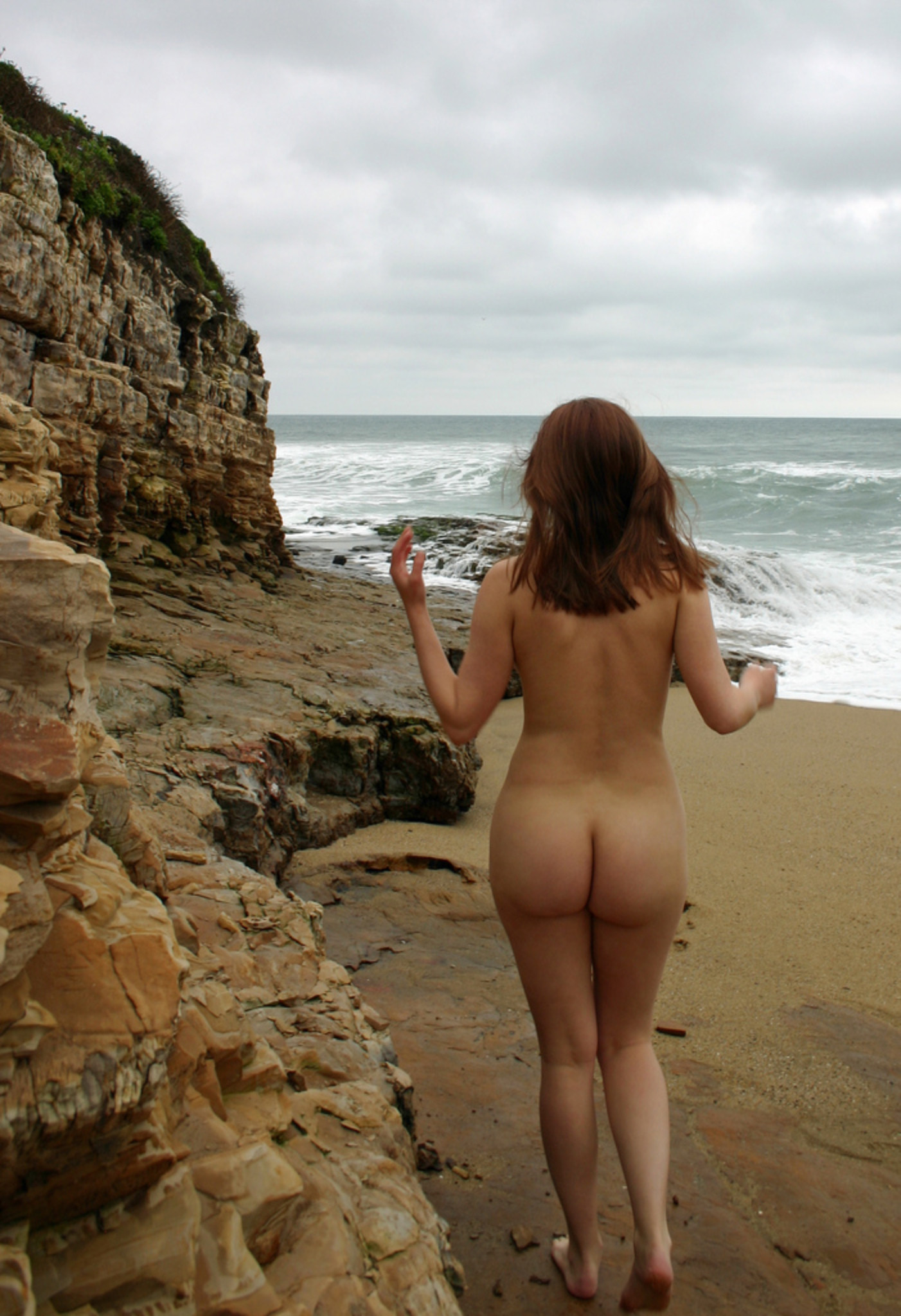 Walking naked on empty beach to feel the nature
