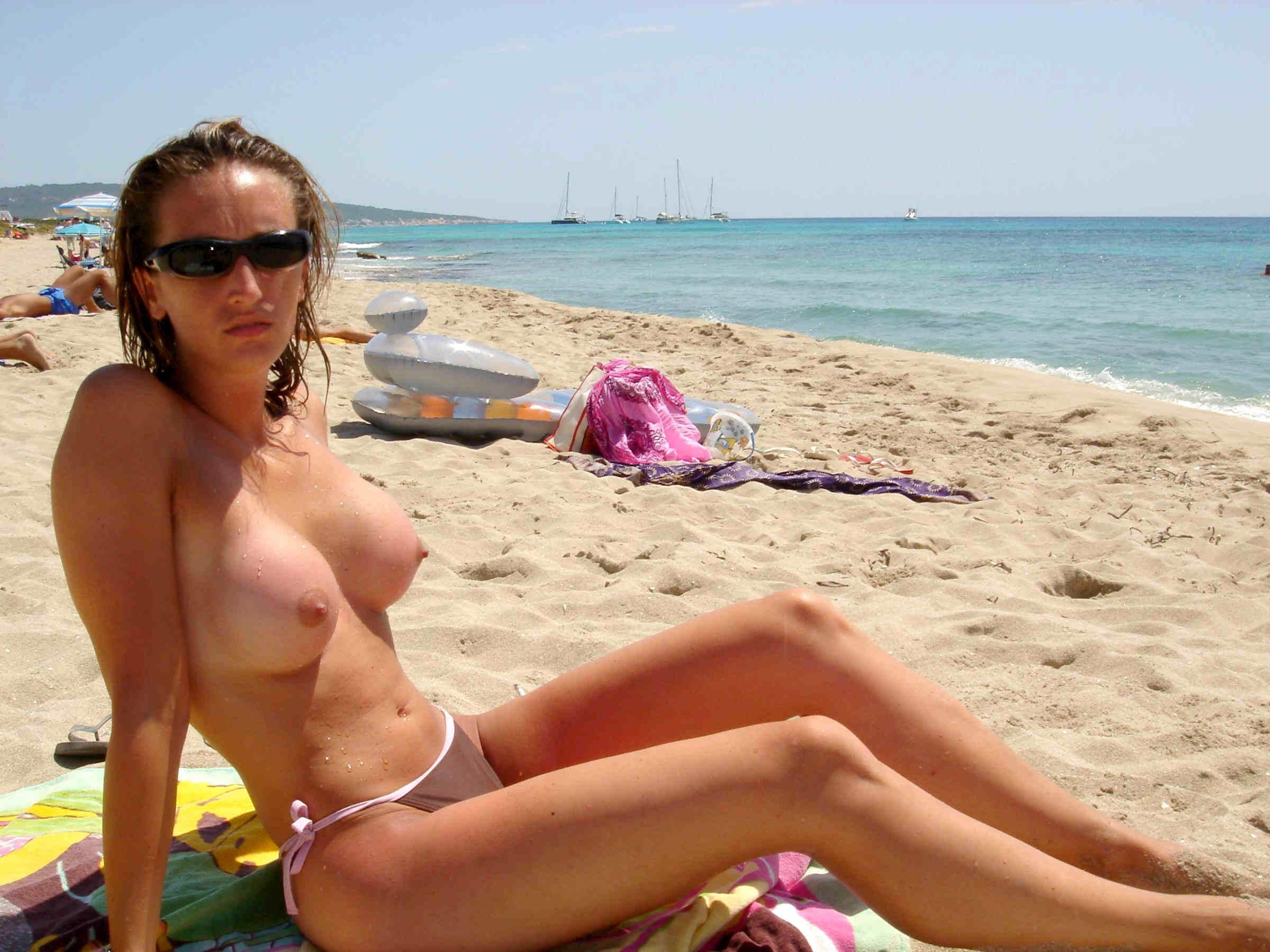 Hot topless chick on the sunny beach