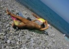 Naked hottie enjoying some summer reading