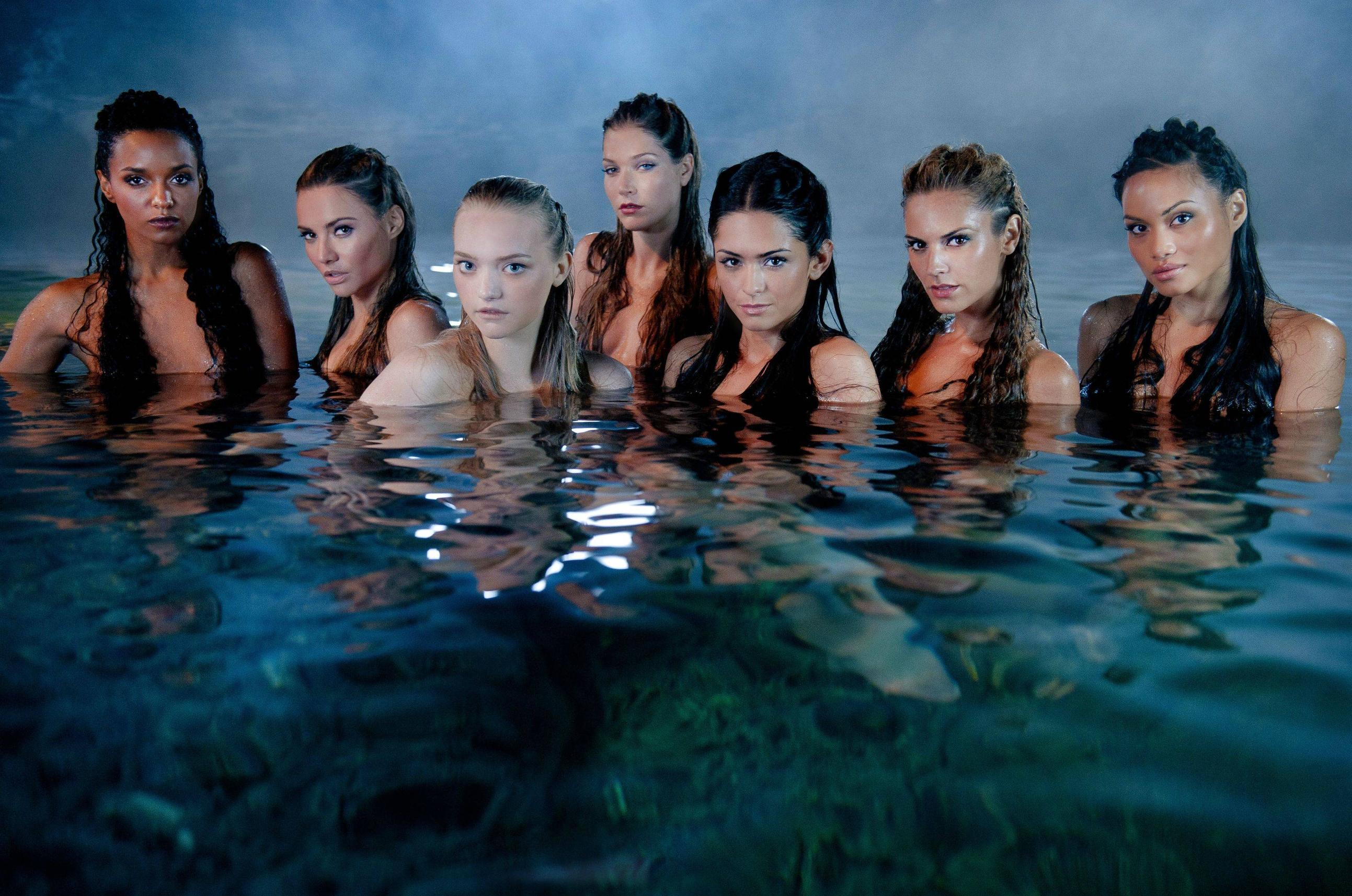 Naked babes posing in the water